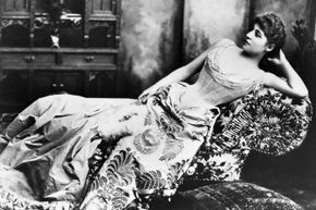 Actress Lillie Langtry reclines circa 1888, perhaps waiting for the butler to let her know someone is calling.