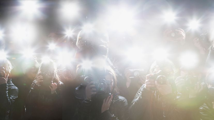 Multiple camera flashes by paparazzi cameras