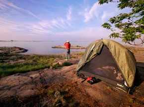 National Parks Image Gallery Some people camp at designated campgrounds, and others seek out their own scenic spots. See some scenic spots in these pictures of national parks.