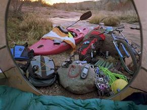 In addition to your tent and sleeping bag, bring along your kayak and bikefor your camping adventure.