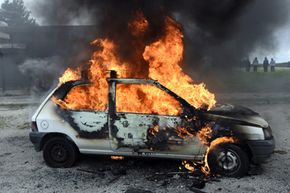 Could this fire have been caused by a bullet hitting the car's fuel tank? (Probably not.)