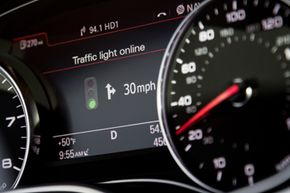 Traffic light information is displayed on Audi's Driver Information System (DIS) located in the vehicle's central instrument cluster.