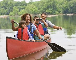 The thrills and excitement of canoeing attract people of all ages, like this family.