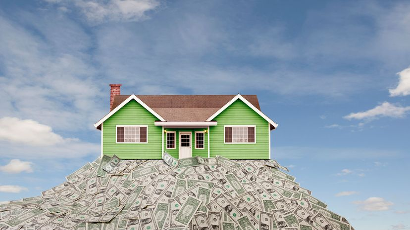 house on pile of cash