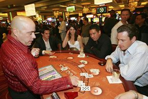 Patrons play blackjack during the grand opening of the Red Rock Casino.