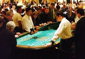 Gamblers are seen playing Craps at Caesars Palace Hotel and Casino. See more casino pictures.