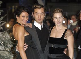 """Casting directors originally pictured Hugh Grant in the role that became Jude Law's in """"The Holiday."""" Here Law, center, is pictured with co-stars Cameron Diaz, left, and Kate Winslet, right."""