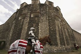 A knight readies for a joust at the Tower of London.