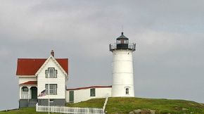 ©2007 Erik Anestad                              Although visitors to the Cape Neddick Lighthouse are separated from the tower by a short expanse of saltwater, the best views are actually from the nearby coast. See more pictures of lighthouses.