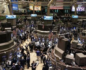 Investing Image Gallery Traders work on the floor of the New York Stock Exchange. Even the United States doesn't have a true capitalist economy. See more investing pictures.
