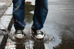 Rain photography can capture the unexpected -- someone trying to jump a puddle or even landing in it. See more pictures of cool camera stuff.