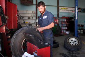 Mechanic balancing a tire