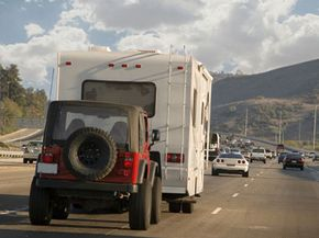 Said, how's that RV pulling that car? With a tow bar, with a tow bar!