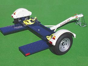 A tow dolly for use in two wheel car towing.