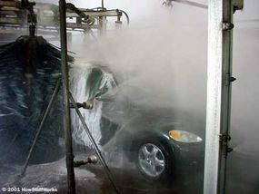 The powerful water jets remove most of the detergent and grime from the car.