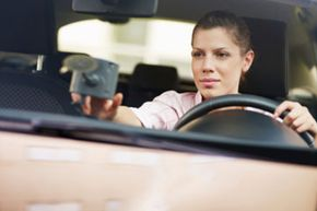 Add-on car accessories, like that GPS on your windshield, can cause distracted driving or become projectiles during an accident.