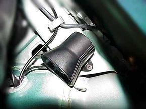 A Neo mini siren, hidden inside a vehicle's front fender