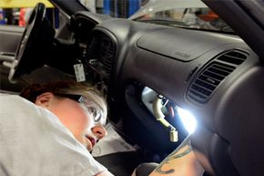 Auto tech Becky McInnis reinstalls an airbag after changing the inflator module on a 2003 Toyota Tundra.