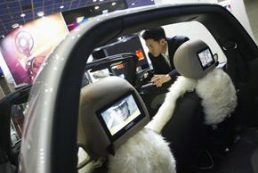 A man admires the excellent integration in a new car in Seoul, South Korea.