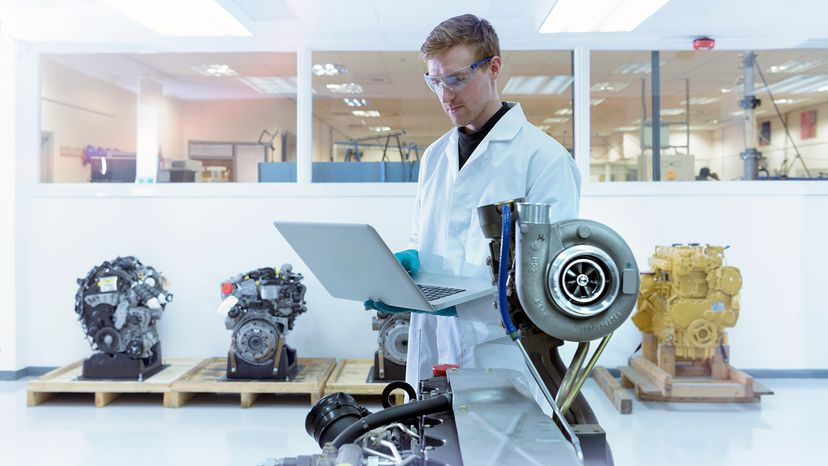 scientist studying turbocharger