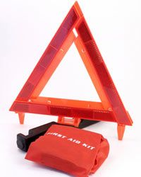A first aid kit and a reflective triangle are just two parts of a good emergency car kit for foul weather.