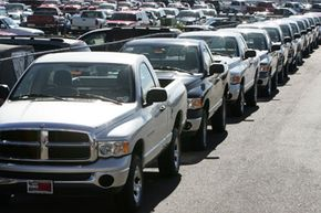 A long line of Dodge Ram pickup trucks sits on the lot of a Dodge dealership in Littleton, Colo.