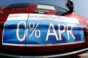 Zero percent interest rate availability is draped on the side of an unsold 2008 Denali at a GMC Truck dealership in Littleton, Colo.