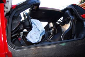 The deployed airbag inside the remains of an Enzo Ferrari. See more car safety pictures.