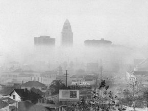 This photo, taken in 1956, shows the skyline of downtown Los Angeles including the city hall (center), the United States Courthouse (left) and Hall of Justice (right) obscured by smog.