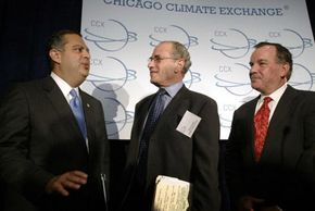 Dr. Richard Sandor (center), chairman and CEO of the CCX, speaks with U.S. Secretary of Energy Spencer Abraham (left) and Chicago Mayor Richard Daley after the CCX's first allowance auction in 2003.
