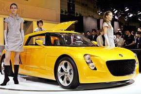 """Volkswagen unveiled its new concept car, the """"Eco Racer,"""" in 2005. The car featured a carbon fiber body. See more small car pictures."""