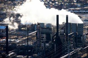 Carcinogens that cause cancer may be all around us, like in the air pollution from this factory in East Chicago, Indiana.