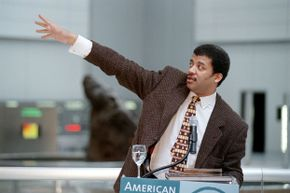 Neil de Grasse Tyson, astrophysicist and director of the Hayden Planetarium, speaks during a press tour at the Rose Center for Earth and Space of American Museum of Natural History in New York, 2000.