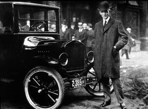 Henry Ford stands next to the Model T. Despite early successes of transportation modes such as railways, streetcars and subways, mass production of automobiles lowered prices, and more roads led many Americans to buy cars. See more classic car pictures.