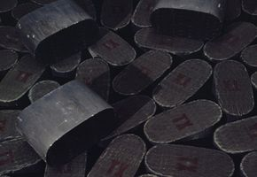 A large pile of platinum lined catalytic converters. See more green living pictures.