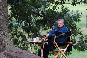 Robert De Niro enjoys a snack, apparently provided by craft services, on the set of 'The Intern' in Prospect Park, Brooklyn.