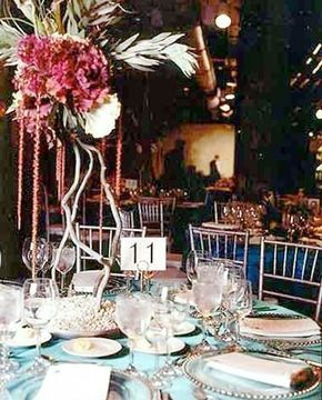 Photo courtesy Joel                              The catering company can work with the florist to create centerpieces to match the table setting.