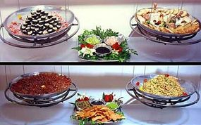 Photo courtesy Joel                              Innovative presentation: buffet selections are suspended from above for a floating effect.
