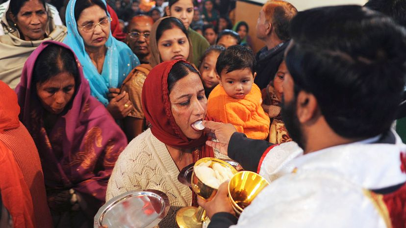 Father Kolenchery Roby administers Holy Communion to a parishioner with a special wafer at the St. Francis Catholic Church in Amritsar, India, on Dec. 25, 2011. Narinder Nanu/AFP/Getty Images