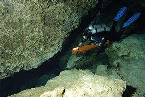 Stiff fins help cave divers move through the water easier, while dry suits keep them warmer.