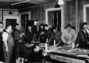 Members of the Civilian Conservation Corps work in a lab class designed to provide vocational education, 1936. The CCC recruited nearly 3 million men from 1933-1942.
