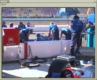Practicing before the race, the Motorola car leaves the pits.