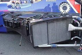 The two side pods on either side of the driver house the car's electronics and the channels feeding air to the radiators. In this photo, you can also see the fuel filler area, which leads to the gas tank just behind the driver.