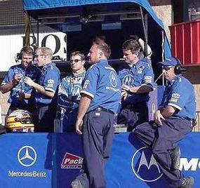 Mark Blundell talking with the team before a race