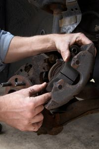 Remove any hardware holding the old brake padsin place (if any) and they should slide right out.