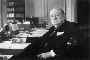 Prime Minister Winston Churchill, photographed at 10 Downing Street wearing his trademark bowtie and holding his usual cigar.
