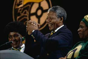 Nelson Mandela and his then-wife Winnie (left) attend a concert at Wembley Stadium to celebrate his release from prison in 1990.