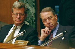 Senate Finance Committee Chairman Max Baucus (left) and Sen. Charles E. Grassley (R., Iowa) listen intently during a discussion of charitable tax deductions.