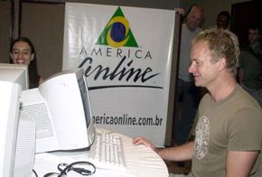 Rock musician Sting chats with fans in an online chat room during a 2001 festival in Rio de Janeiro, Brazil.