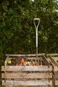 A compost bin is a free source of soil-enriching material.